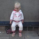 Perle sits with handbag