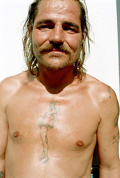 Homeless - Copenhagen - Homeless man with tattoo on his chest.
